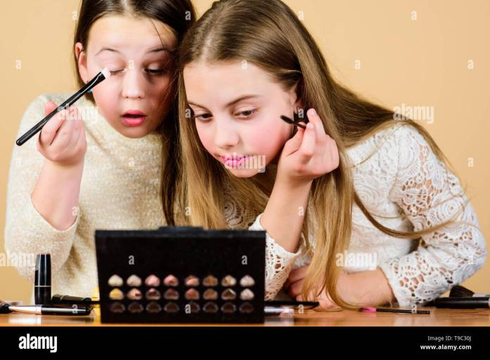 Tutorial For Beginners Little Girls Doing Face Painting And Makeup Tutorial Beauty Tutorial For Young Skin Small Artists Sharpening Their Makeup Skills With Tutorial Or Masterclass Stock Photo Alamy