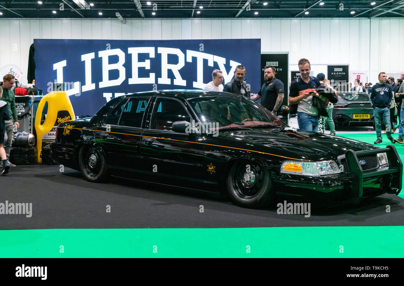 hight resolution of black lowered iconic american police interceptor car ford