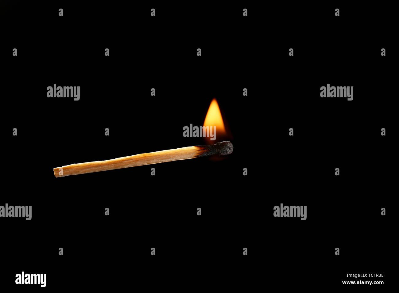 burning match on dark