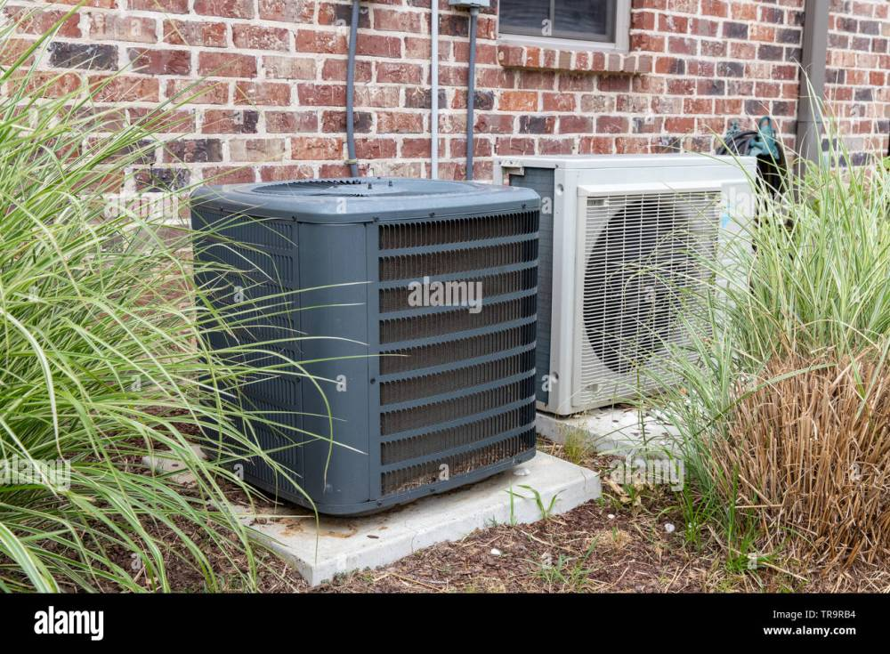 medium resolution of hvac air conditioner compressor and a mini split system together next to each other