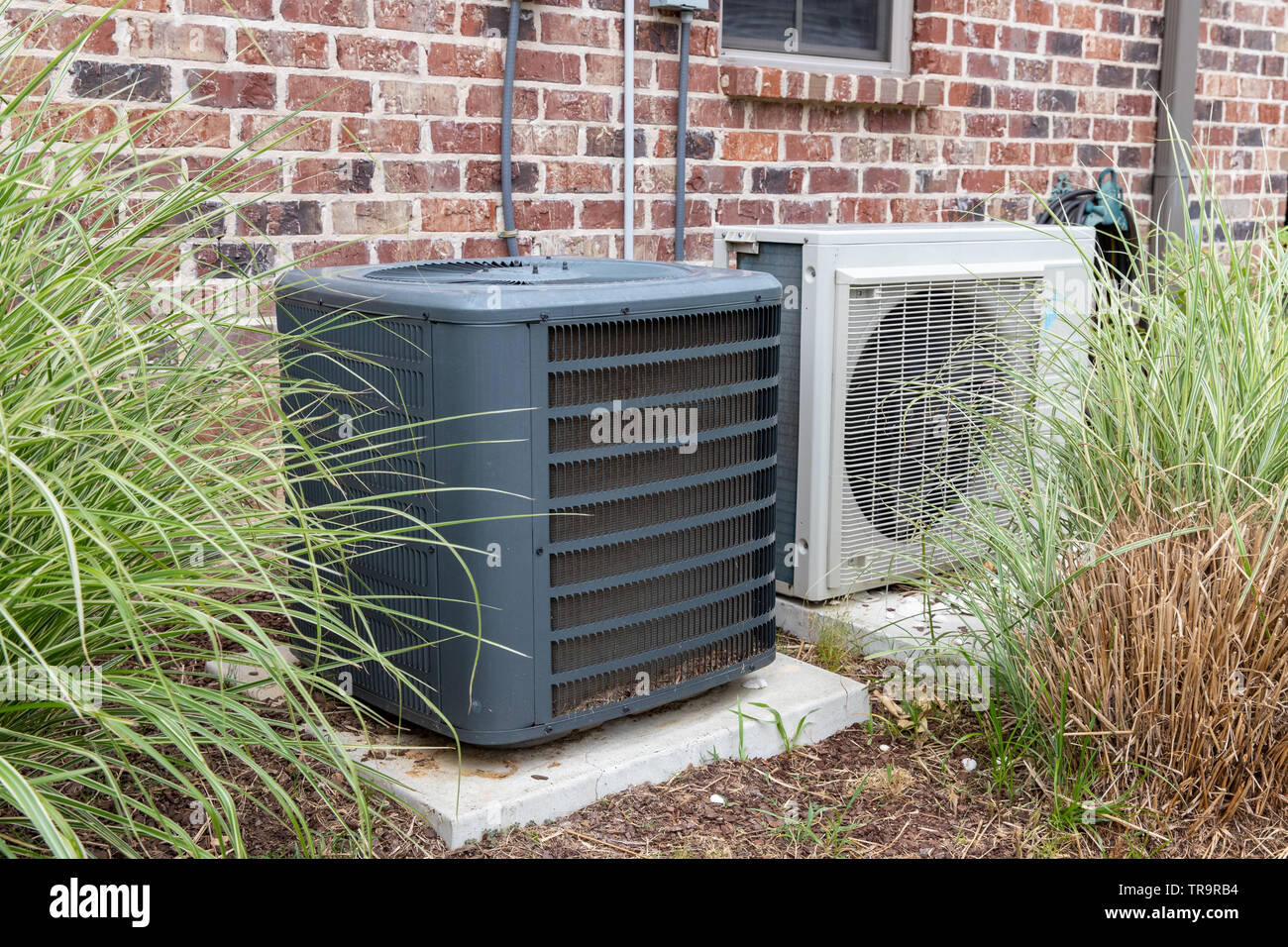 hight resolution of hvac air conditioner compressor and a mini split system together next to each other