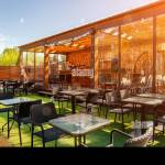 Summer Empty Outdoor Cafe At Park Bar With Modern Design Wooden Walls High Bar Stools Wooden Bar Tables Stock Photo Alamy