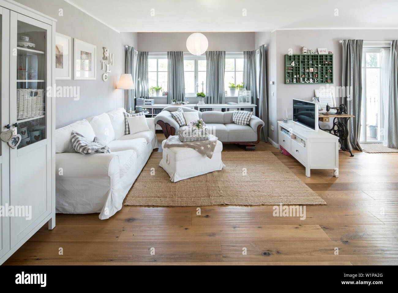 https www alamy com modern nordic living room in family house with white and gray furniture and wooden floor korbach hesse germany europe image259261032 html