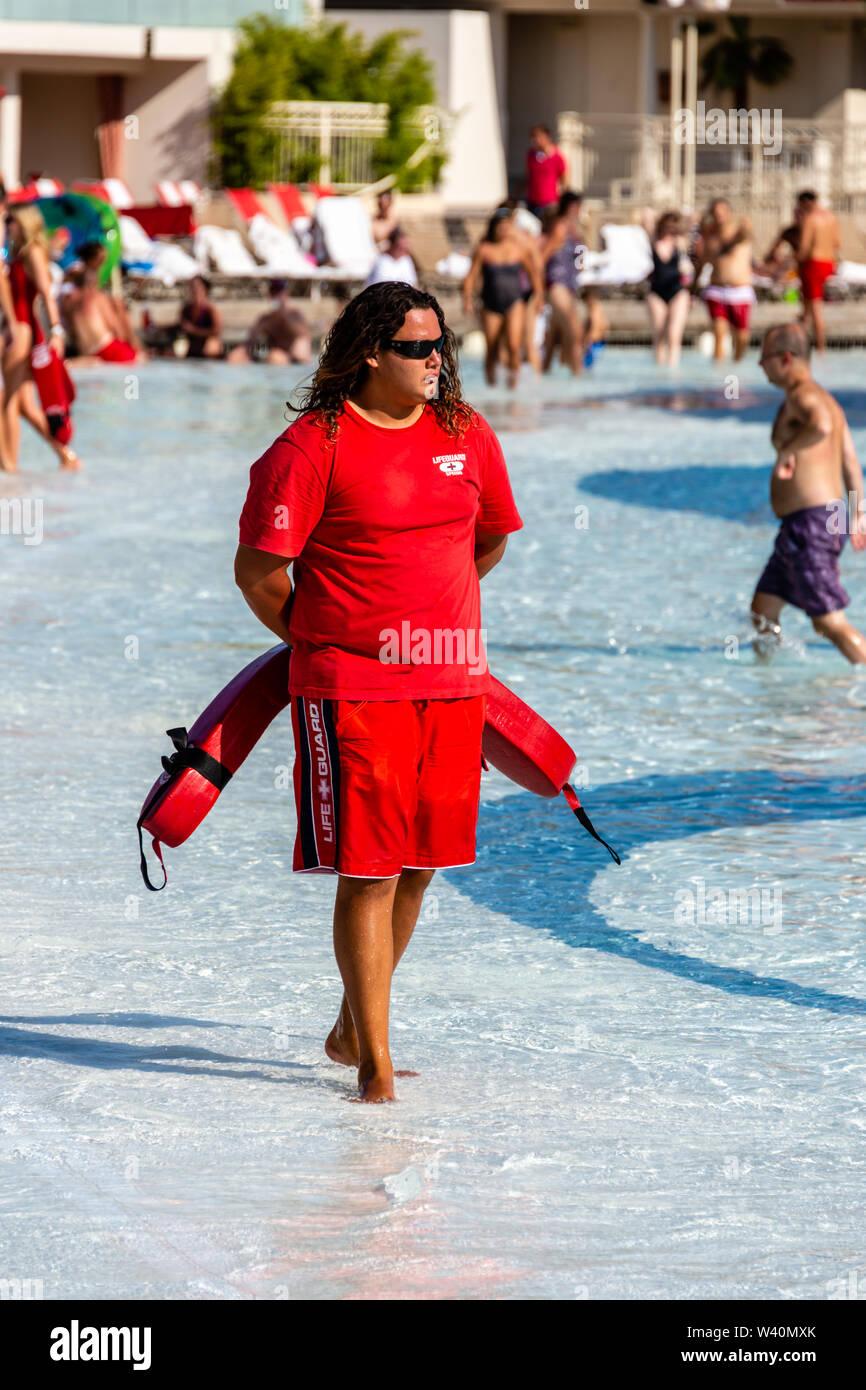 You're not a tourist, you're a. Mandalay Bay Resort Wave Pool Lifeguard Stock Photo Alamy