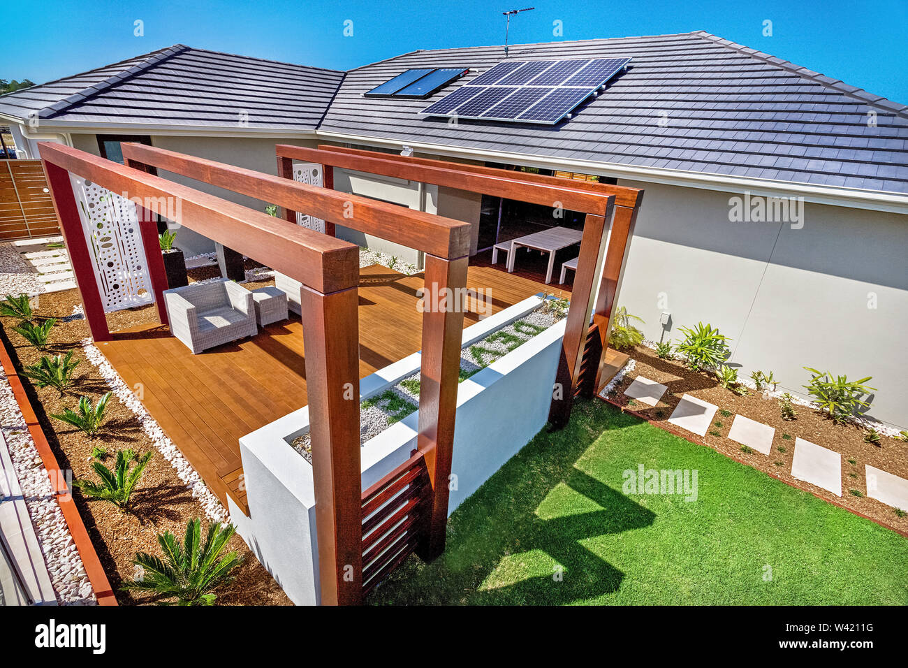 https www alamy com an aerial view of patio featuring wooden panel flooring and solar panels on the house roof image260658876 html