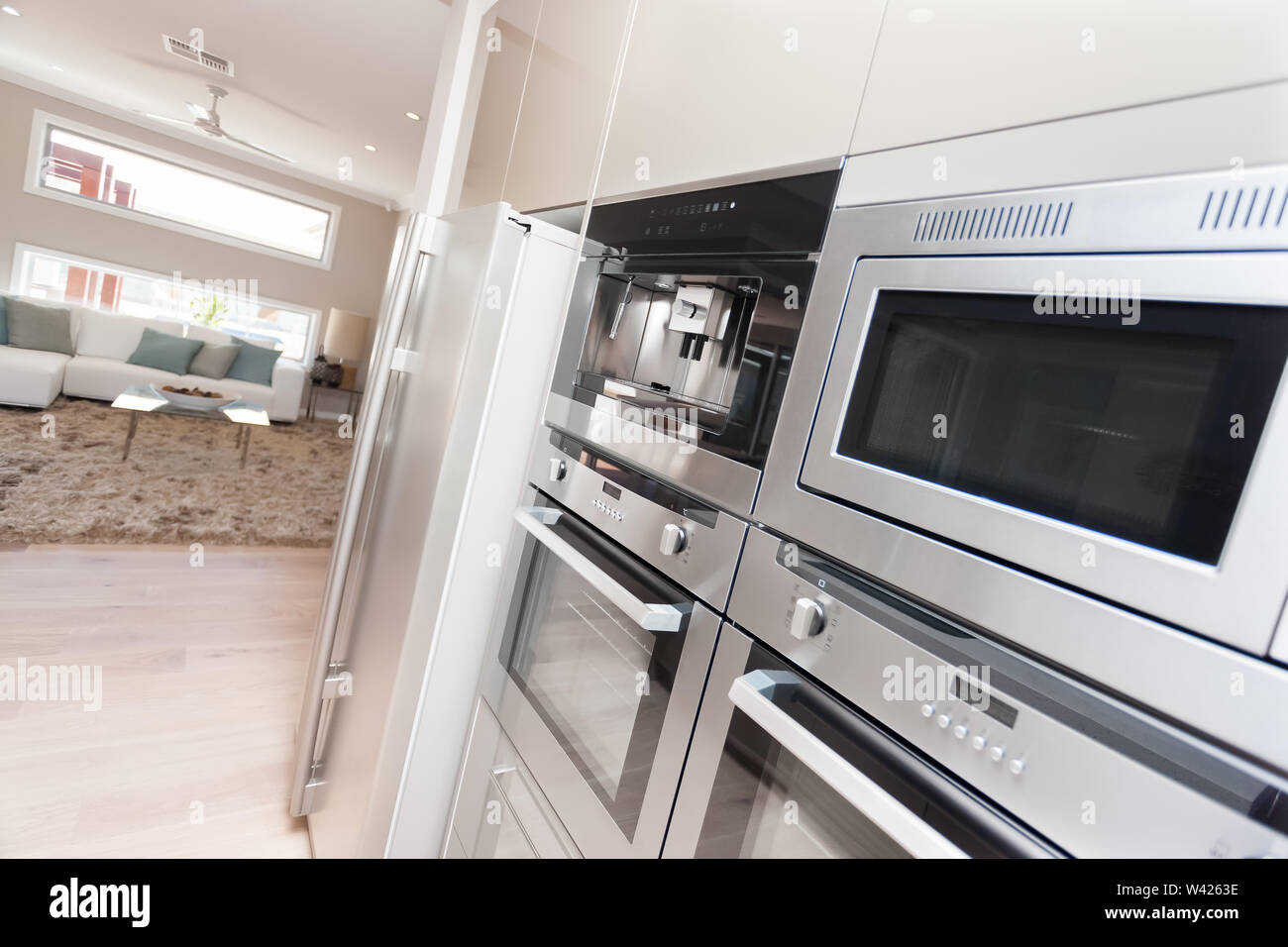 https www alamy com silver microwave ovens and pantry cupboards installed in the wall of in the kitchen the refrigerator is fixed next to the oven and under the pantry c image260662850 html