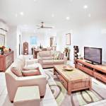 Sofa Set Close To Wooden Table And Television Comfortable Furnitures With Designs Walls Are White Color Pillows On Chairs Inside Rooms Of A Apartm Stock Photo Alamy
