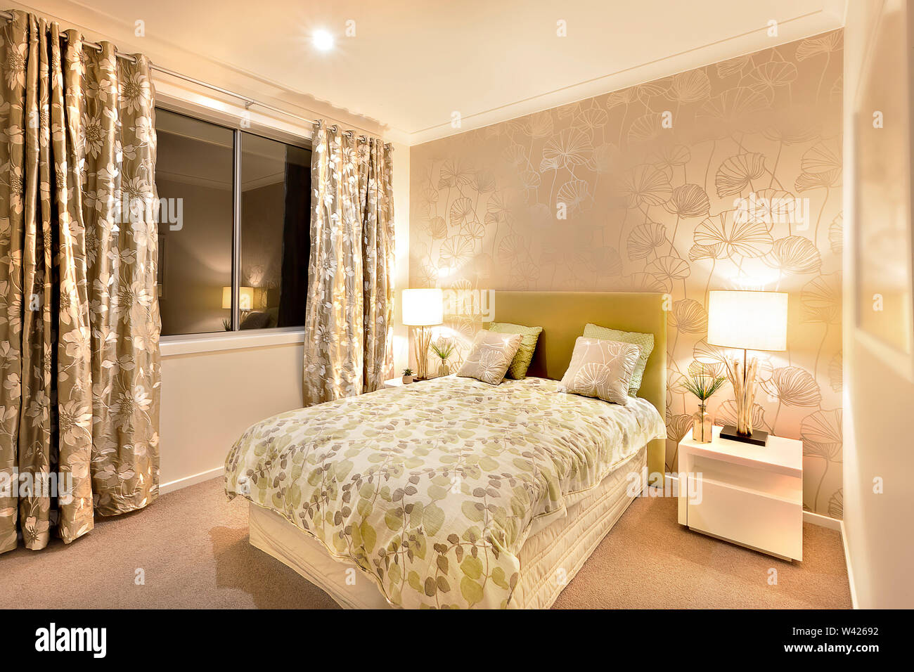 Beautiful Bedroom In Luxury Hotel Or House Illuminated Well With Two Table Lamps Made By Wooden On The White Table The Bed Is Wide Huge And Well Pre Stock Photo Alamy
