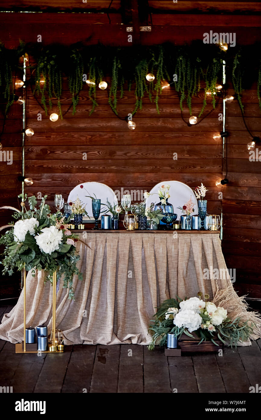 https www alamy com table bride and groom at the wedding banquet wedding floristry brown wooden screentablecloth from simple tissue blue glass hydrangeas roses and image262858536 html