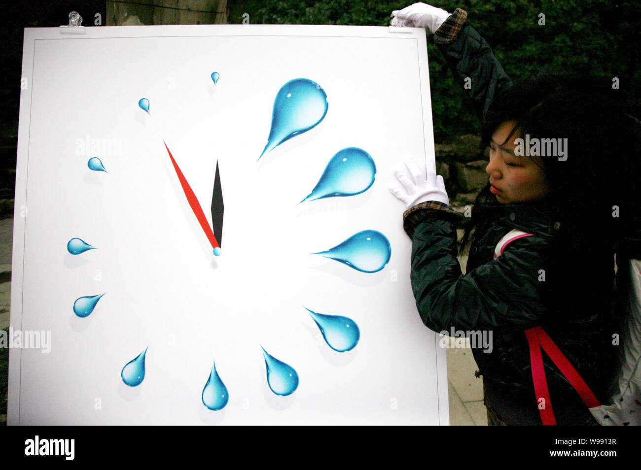 https www alamy com a chinese college student sets up a poster in a water conservation themed poster exhibition on the world water day in nanjing city east chinas jiangs image263885883 html