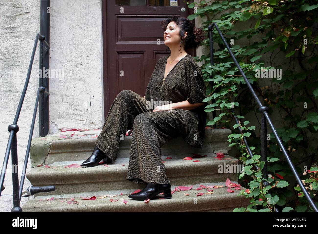 M*T*R* Woman Sitting On Steps Outside House Stock Photo Alamy | Outside Steps For House | Front Door | Entryway | Decorative | Ranch Style House | Beautiful