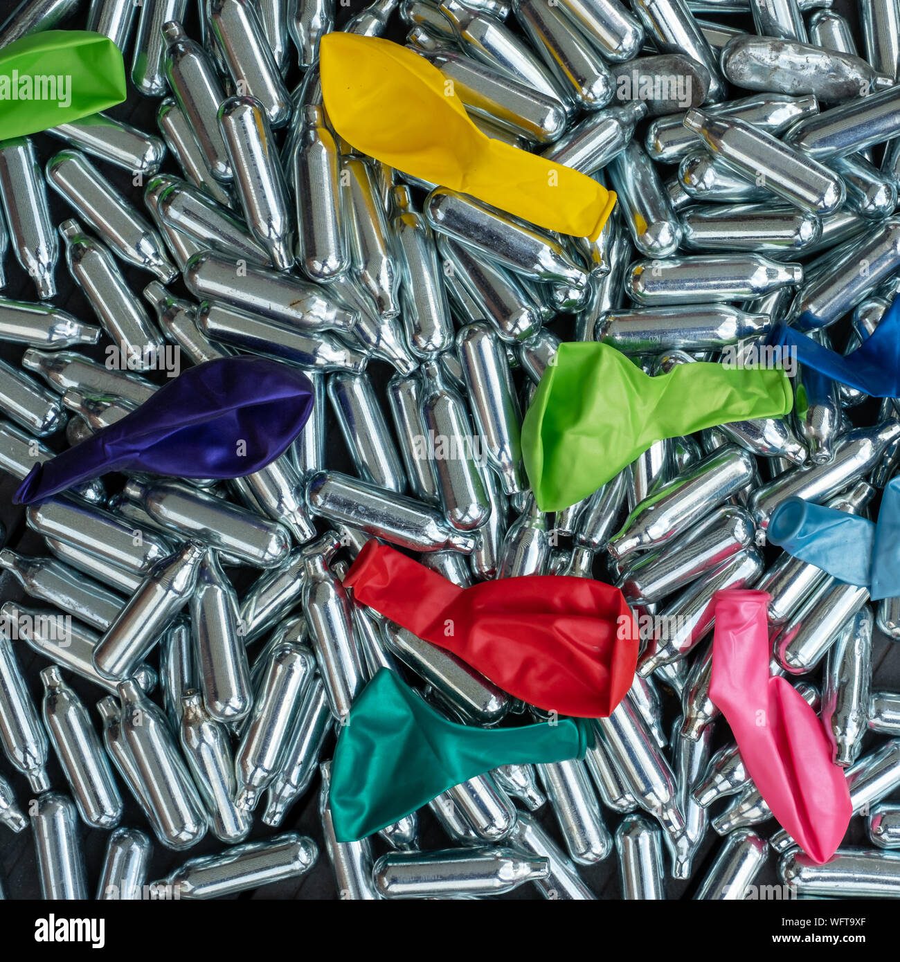 https www alamy com nitrous oxide canisters cream puff chargers and balloons steel cylinders contain nitrous oxide laughing gas which is used for legal high image267910007 html