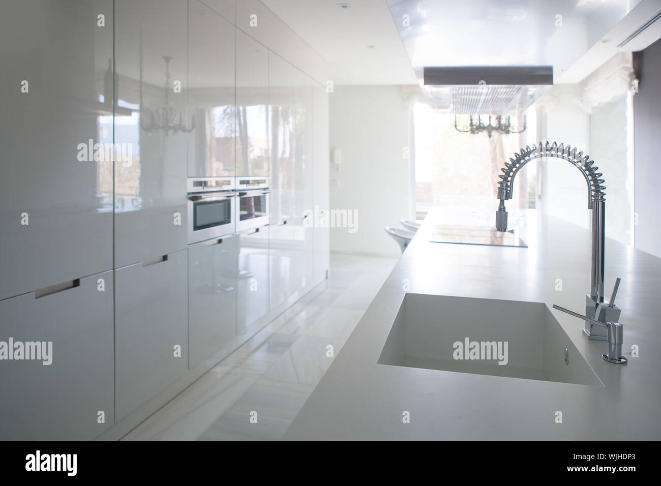 https www alamy com modern white kitchen perspective with integrated bench sink and spring faucet image269603323 html