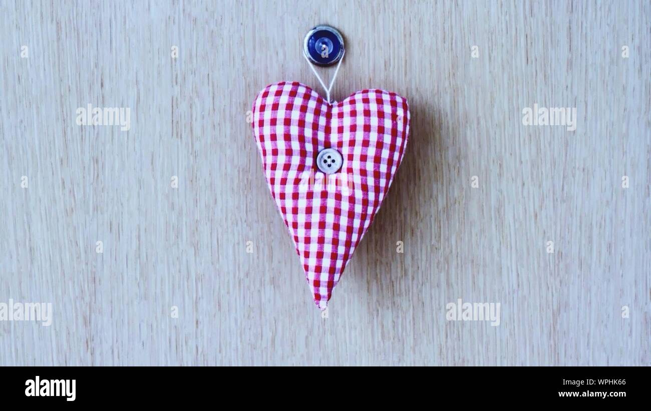 https www alamy com close up of small heart shaped pillow hanging on peephole image272066206 html