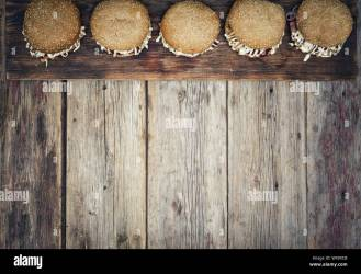 Street food bbq hamburger rustic style wooden background Top view copy space text menu Stock Photo Alamy