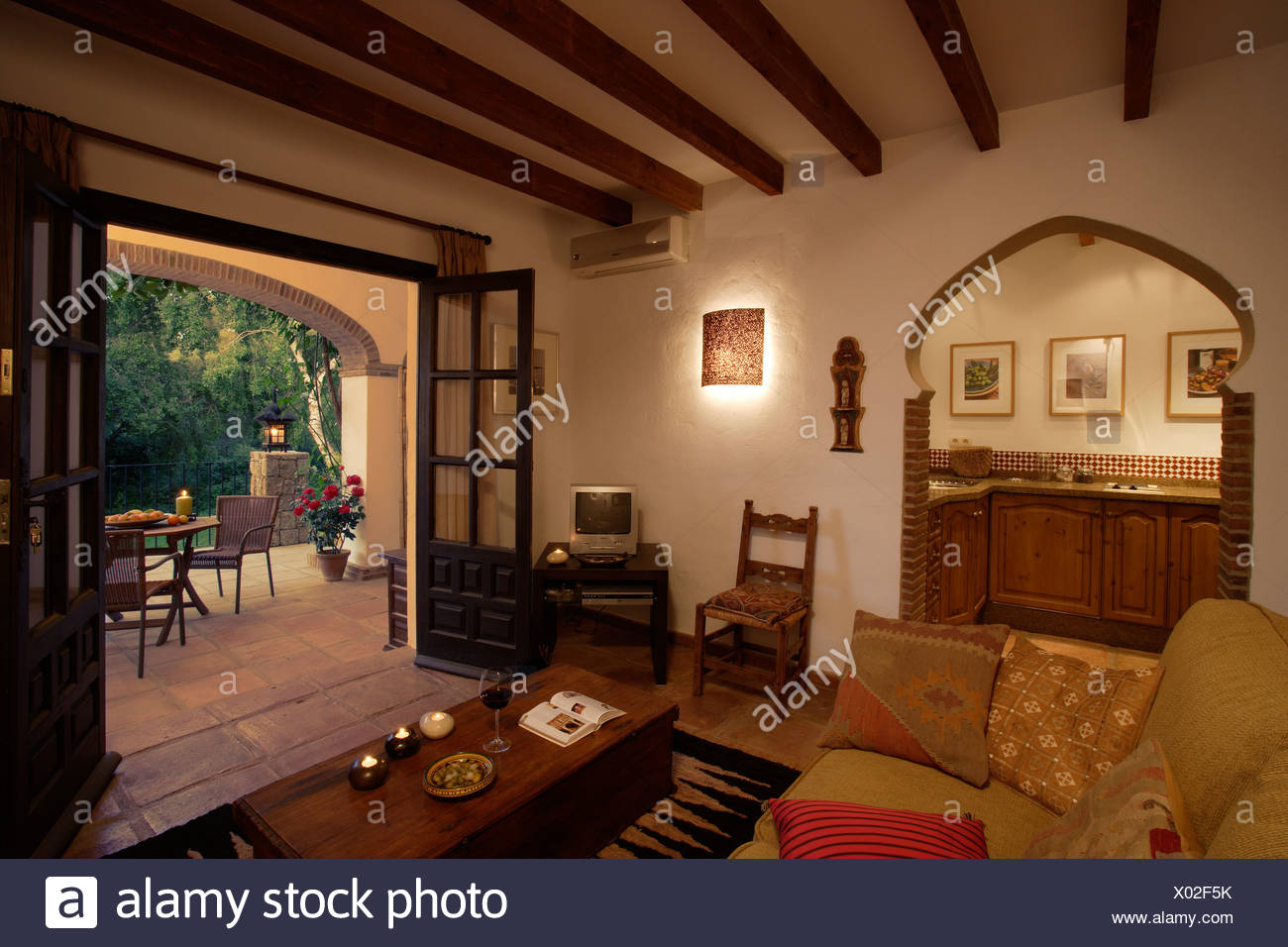 veranda living rooms room sets under 1000 spanish with arched doorway to kitchen and double doors open