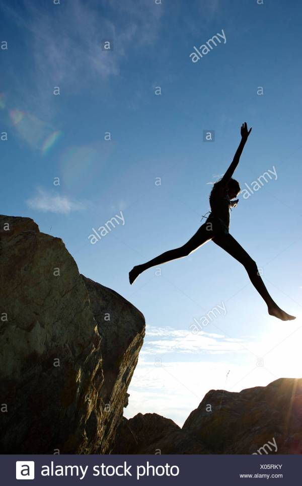 Young Girl Jumping Cliff Stock &
