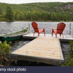 New River Adirondack Chairs Vilmar Chair Instructions Two Red On Floating Dock Stock