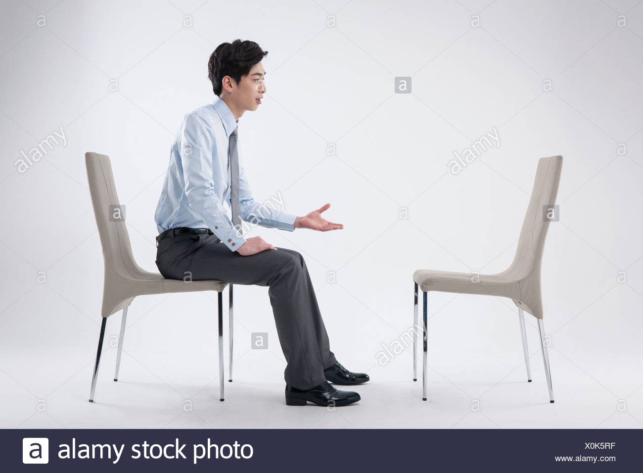the vacant chair human jungle lazy boy wingback chairs a business man sitting and talking to an empty stock