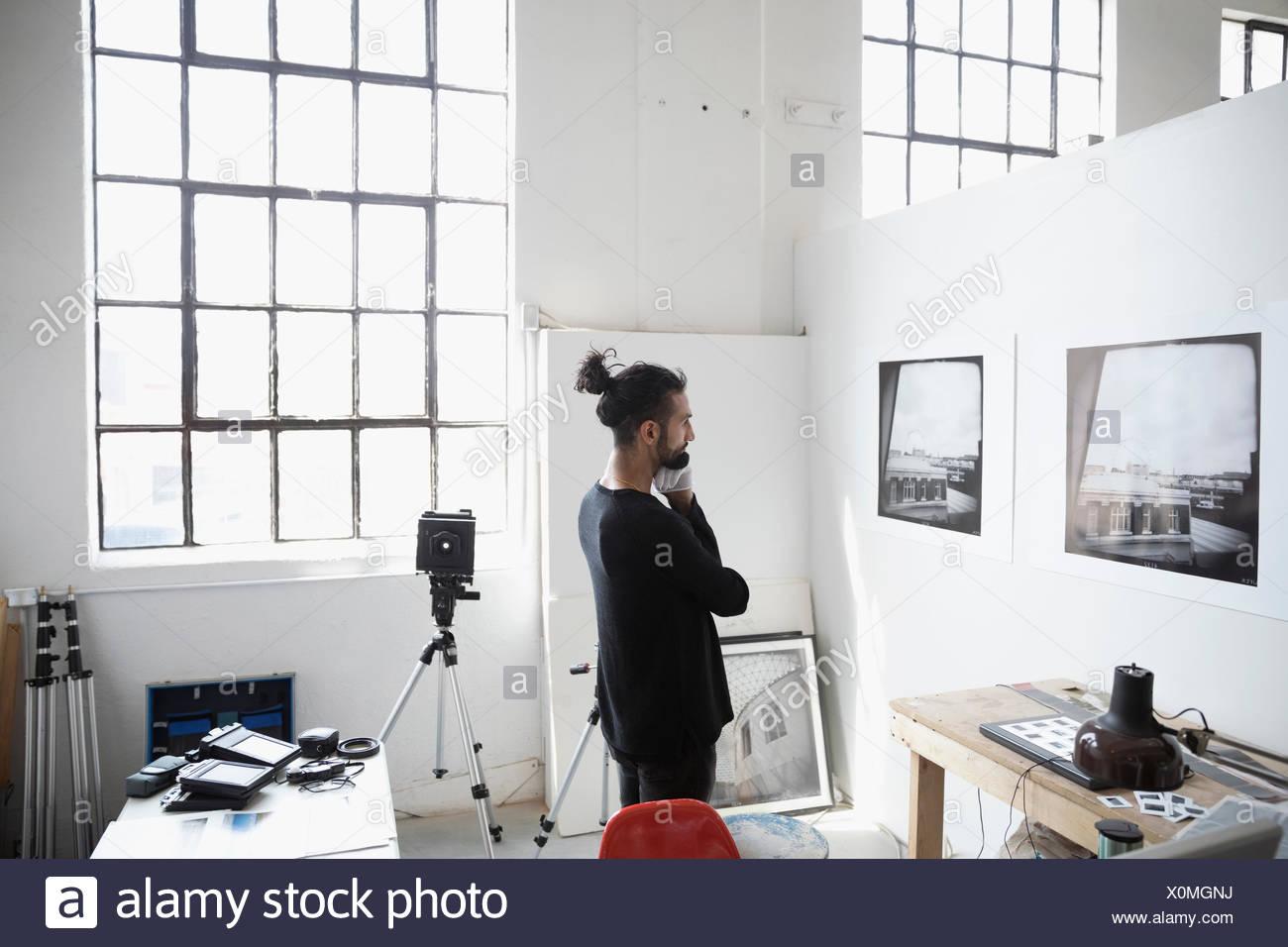focused male photographer examining