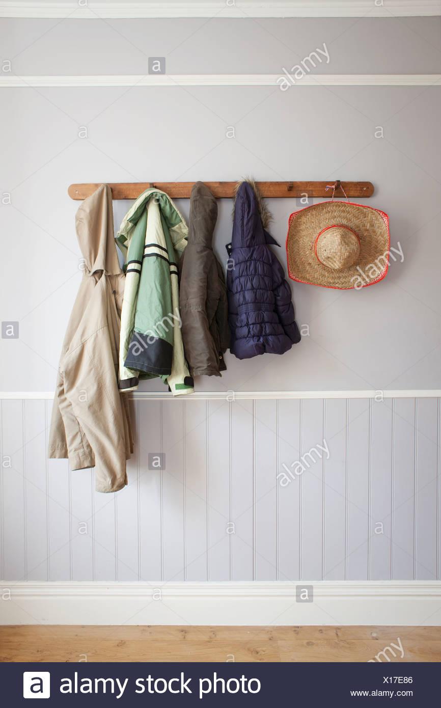 https www alamy com coats and hat on coat rack image276145414 html