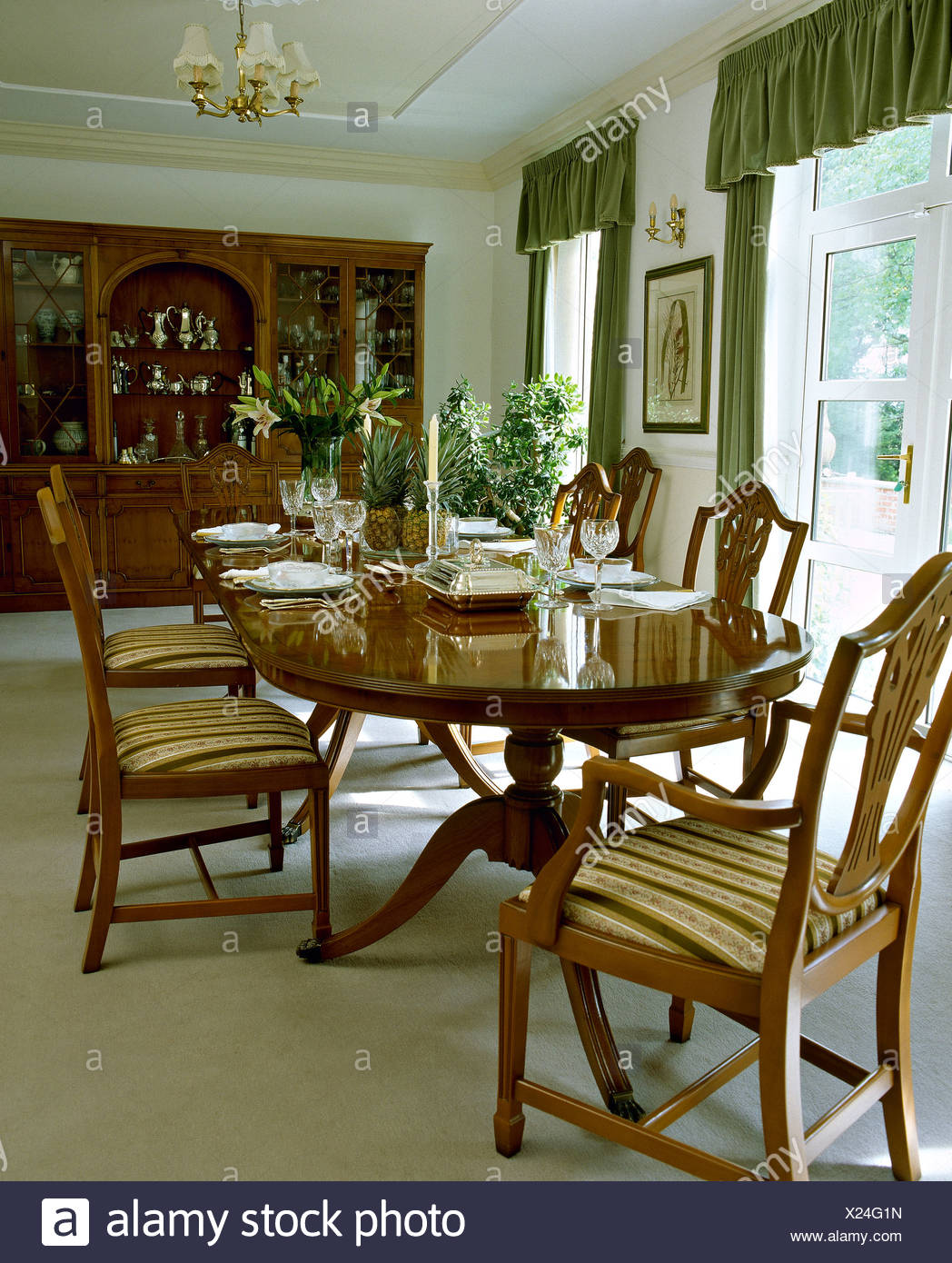 Country Dining Room Chairs Oval Mahogany Table And Upholstered Chippendale Style Chairs In
