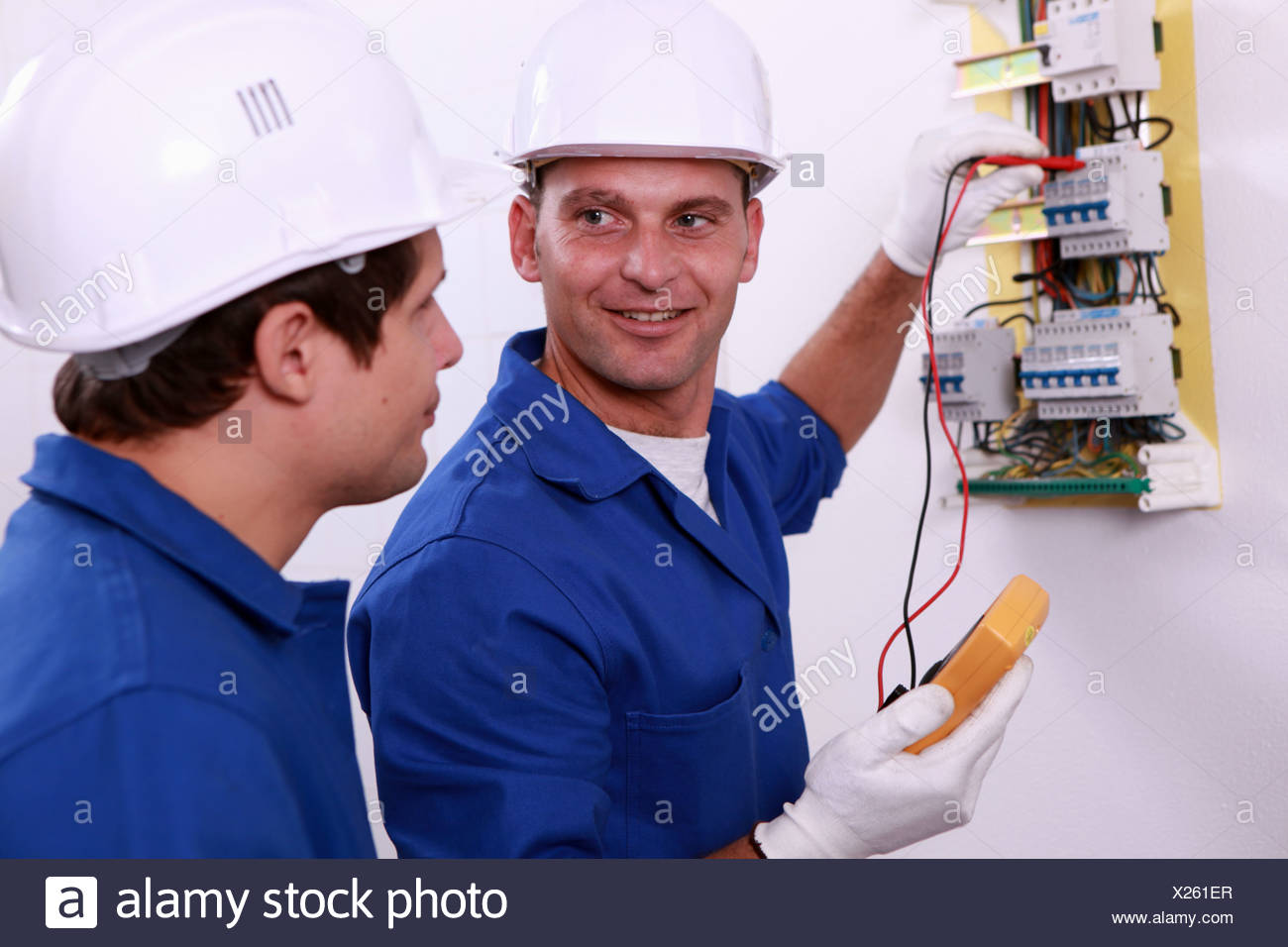 hight resolution of electrical safety inspectors verifying central fuse box