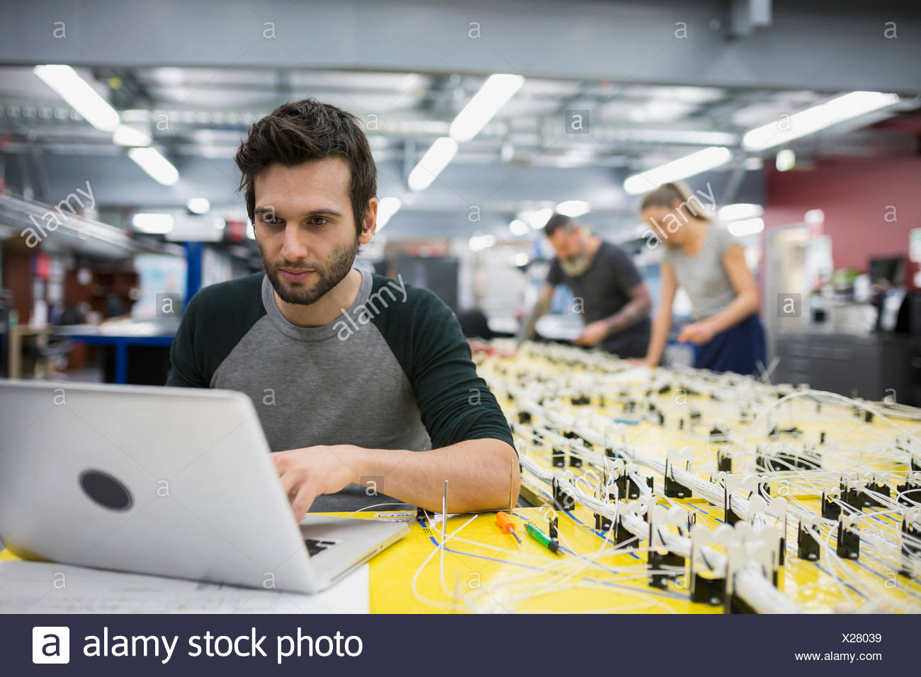 hight resolution of helicopter technician using laptop at wiring harness stock photo funny wiring harness helicopter technician using laptop