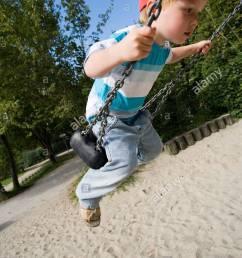 playground boy swing people child baseball cap touched shirt [ 866 x 1390 Pixel ]
