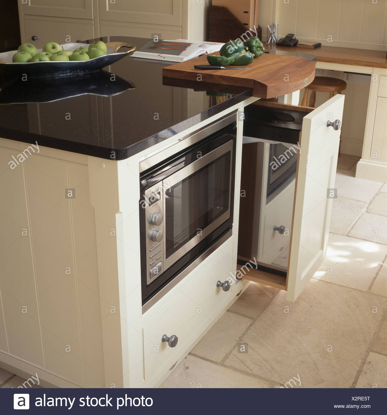 https www alamy com pull out waste bin in granite topped island unit with fitted microwave oven image277111236 html