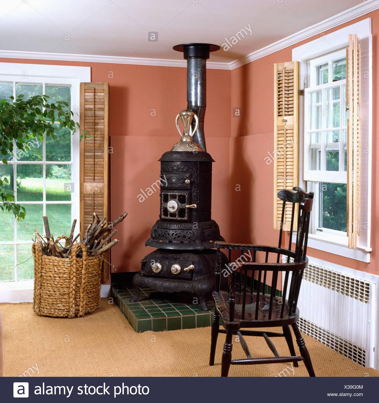 Large Black Stove In Corner Of Sittingroom With Terracotta