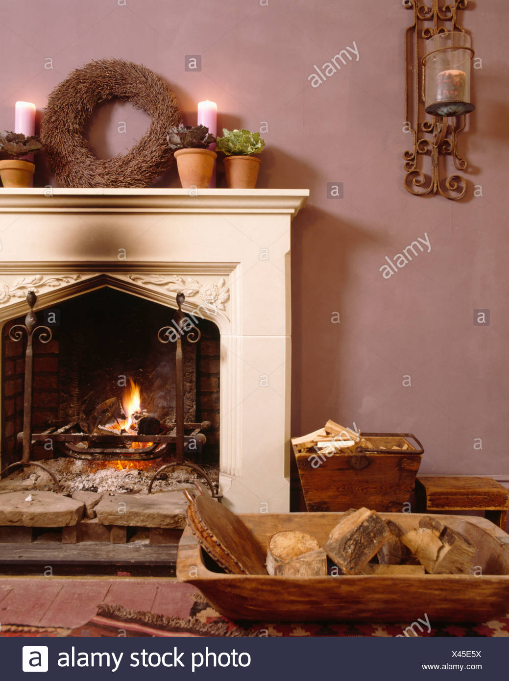 Lighted Candles And Rustic Twig Wreath On Fireplace With