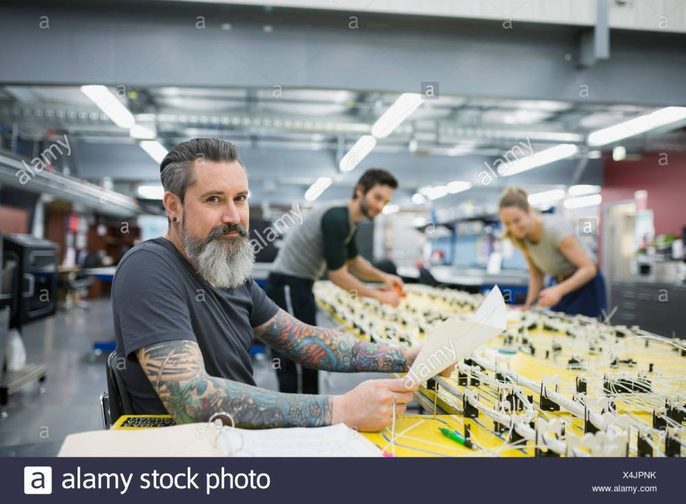 medium resolution of portrait confident helicopter technician at wiring harness stock image
