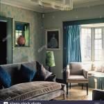 Grey Velvet Upholstered Sofa And Armchair In Sitting Room
