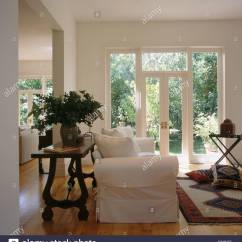 Large Vase For Living Room Interior Design In Indian Style White Sofa Against Antique Table With Of Flowers Modern Tall French Windows
