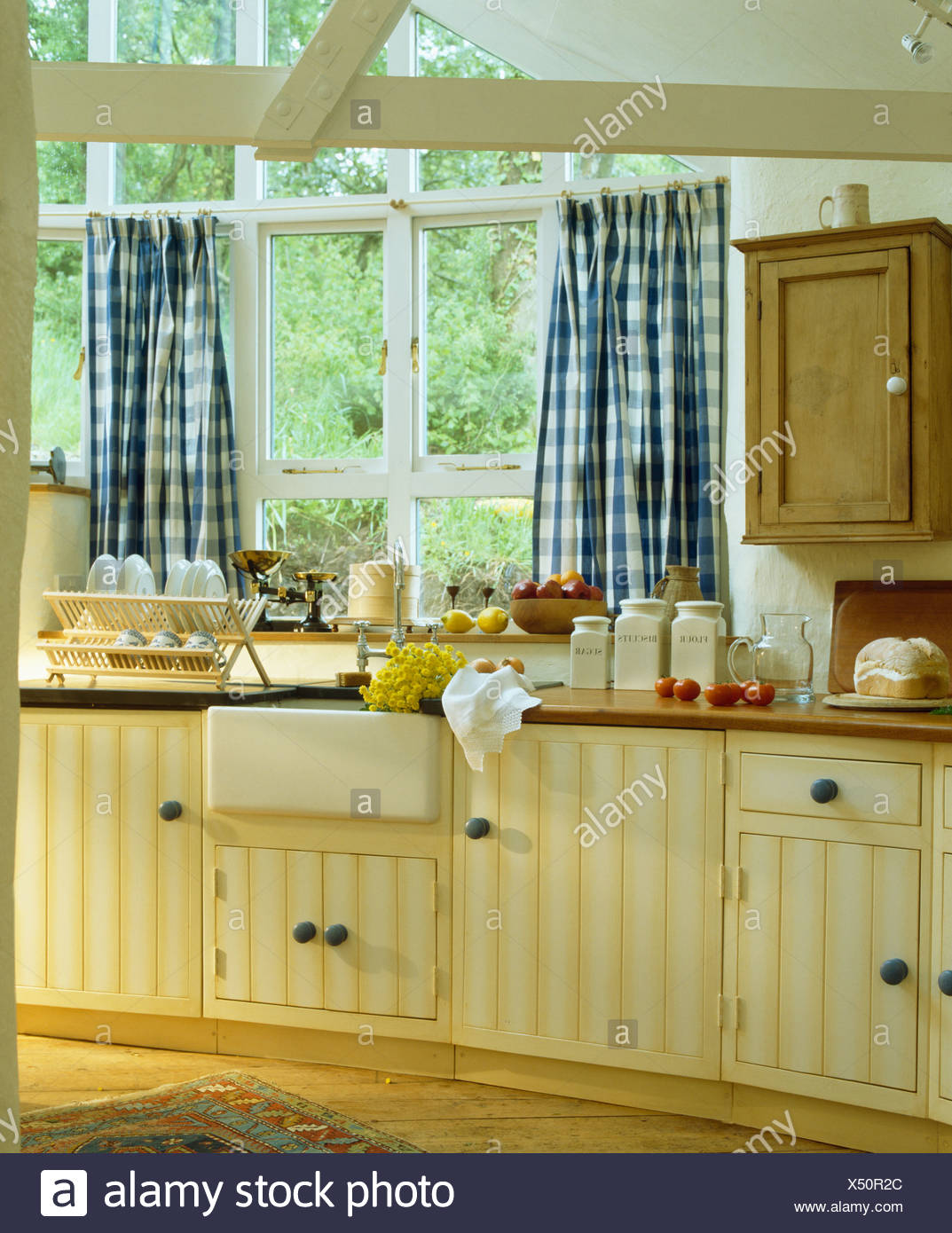 https www alamy com bluewhite checked curtains on window above sink in cottage kitchen extension with pale yellow fitted units image278457268 html