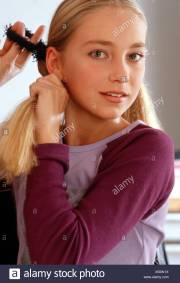 long blond haired preteen girl