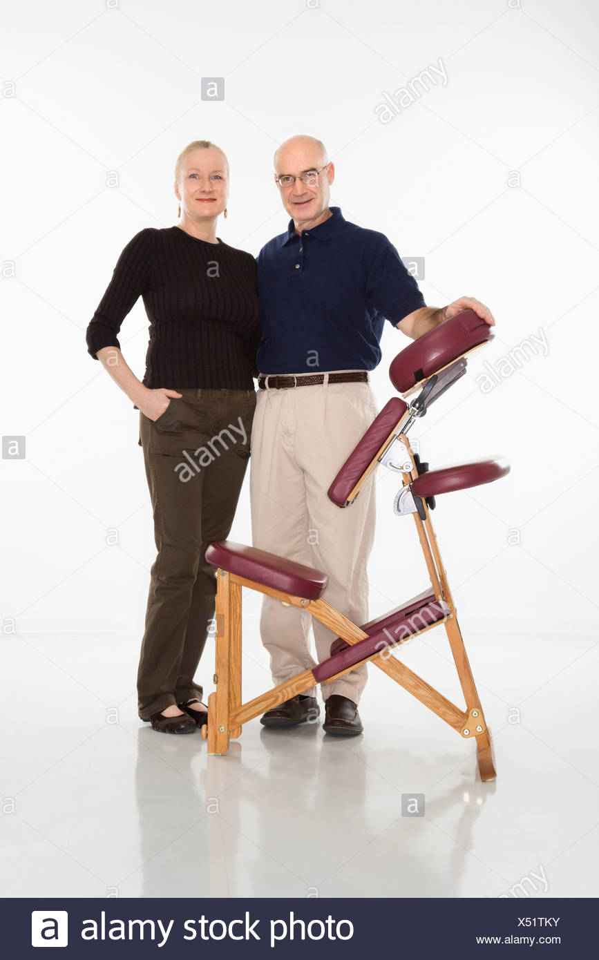 Massage Therapist Chair Caucasian Middle Aged Male Massage Therapist Standing With Arm