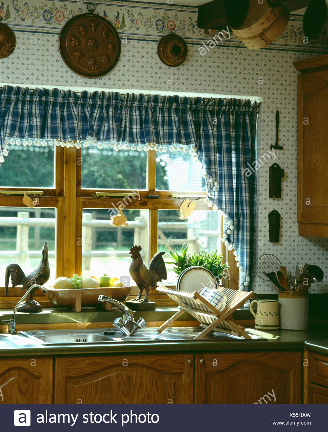 https www alamy com blue white checked curtains and pelmet on window above plate rack on draining board of kitchen sink image278562561 html