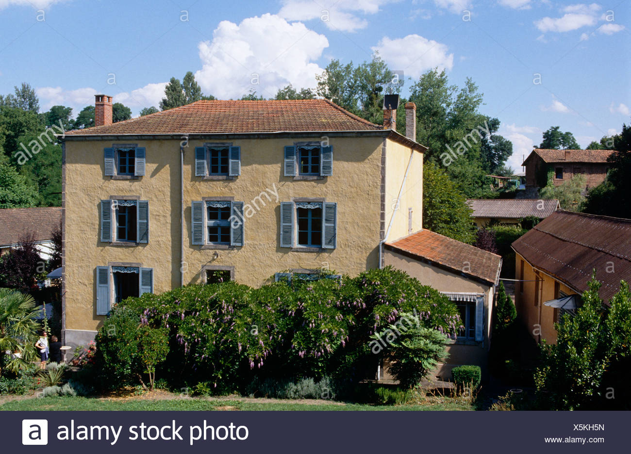 Exterior Of Large French Country House With Blue Shutters