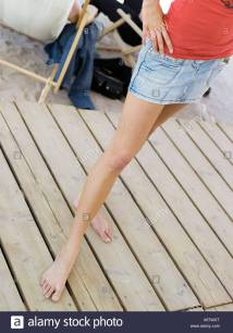 Young Barefoot Woman Wearing Skirt Stock &
