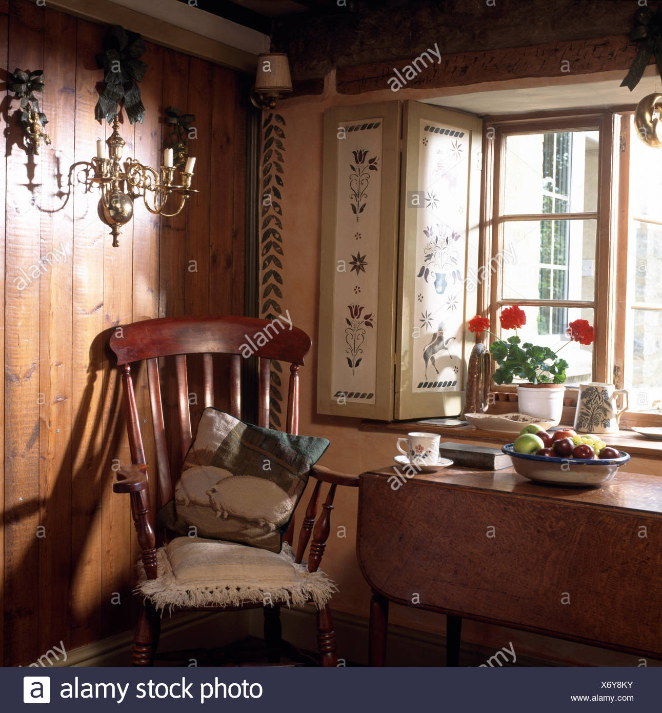 Antique Windsor Chair And Old Table Below Window With