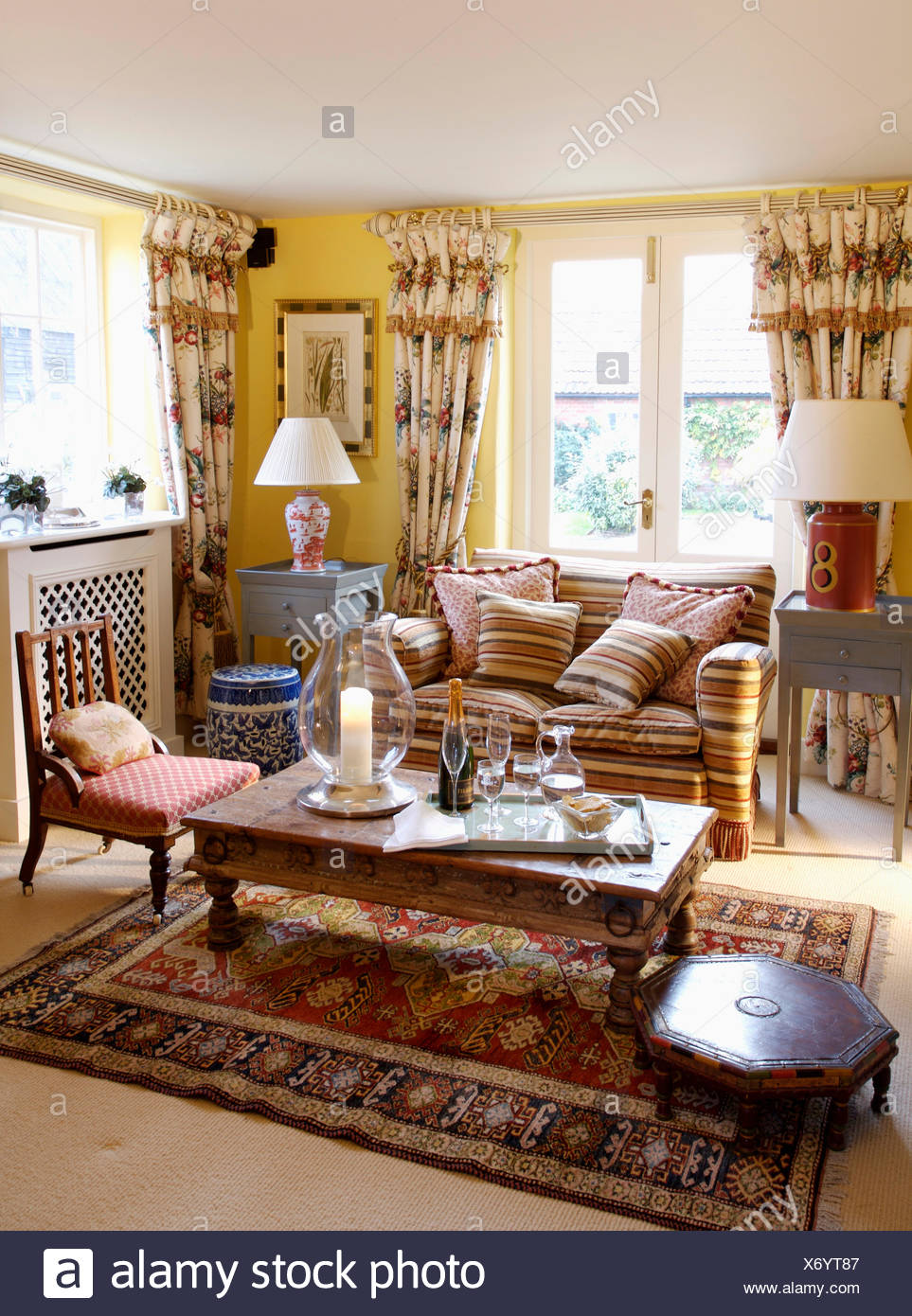 yellow living room rugs modern country style ideas brown striped sofa and floral curtains in with indonesian coffee table on patterned rug