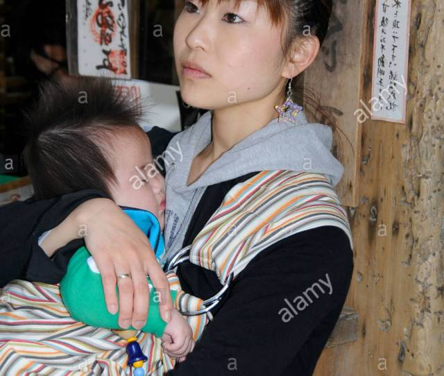 Young Japanese Woman Holding A Baby Kyoto Japan Asia Stock Image