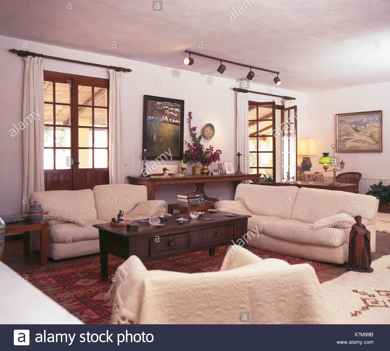 https www alamy com cream sofas and dark wood coffee table in white spanish living room image280114839 html