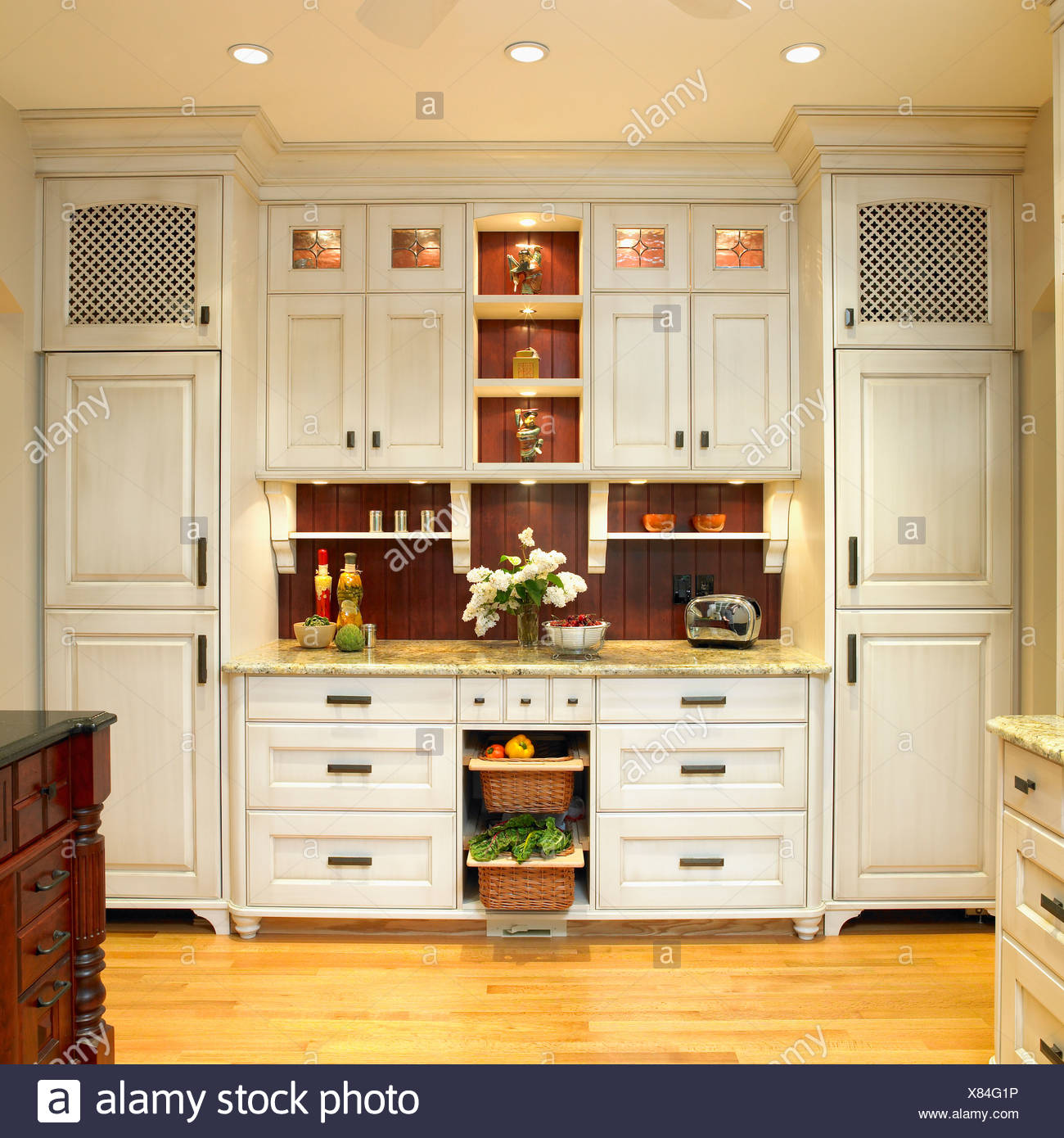 Traditional Built In Kitchen Cabinetry With Cream Finish And Dark
