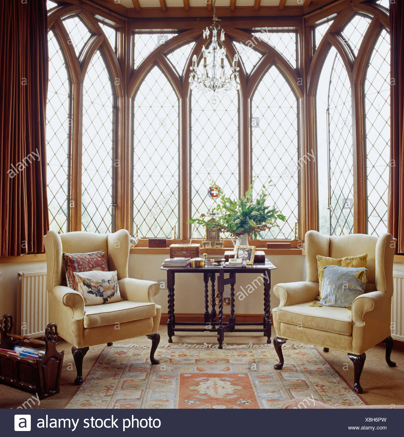 gothic living room furniture layouts photos cream wing back chairs in front of tall style windows country with antique silk carpet