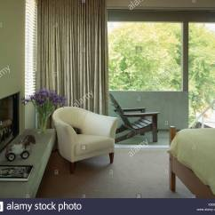 Large Tub Chair Used Zero Gravity Chairs For Sale White In Front Of Window With Gray Drapes Modern Bedroom Balcony