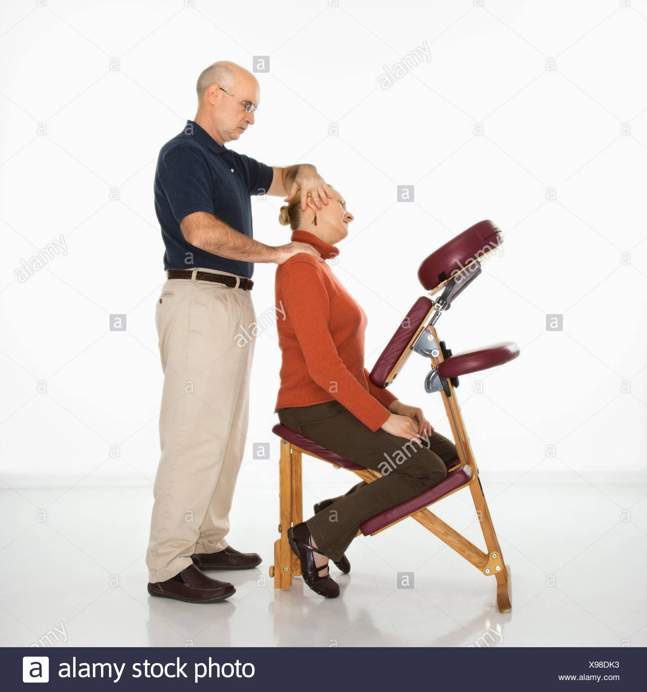 Massage Therapist Chair Caucasian Middle Aged Male Massage Therapist Massaging Neck Of