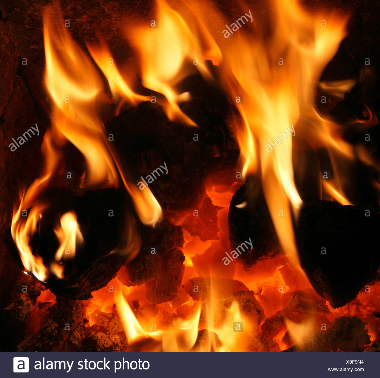 hight resolution of solid fuel domestic coal fire burning flame flames heart fireside heat energy power fires warmth warm home fires